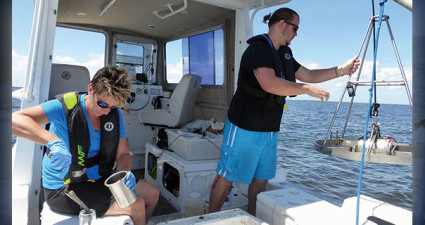 EPC scientists Kevin Campbell and Barbara Goetting conduct benthic sampling this summer in Tampa Bay. Photo by Marcia Biggs/EPC.