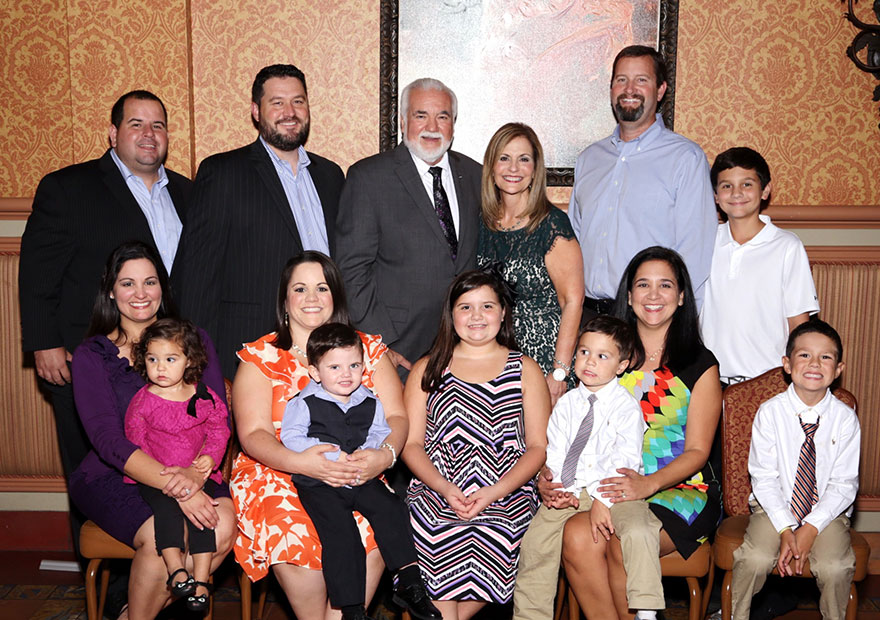 Pumariega's close-knit family joined his retirement celebration at the Columbia Restaurant. Top row, from left to right are son-in-laws Luis Suarez and Troy Howell, Manny and Doreen Pumariega, son-in-law Trey Dean and grandson Charlie Dean. Front row, Dina Pumariega Howell and Grace Howell; Lisa Pumariega Suarez and Lucas Suarez; granddaughter Julia Dean, Natalie Pumariega Dean with Bradley Howell and Justin Howell.